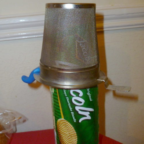 Strainer placed on top of biscuit packet