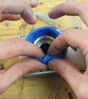 Sugru lens lining being pressed by fingers