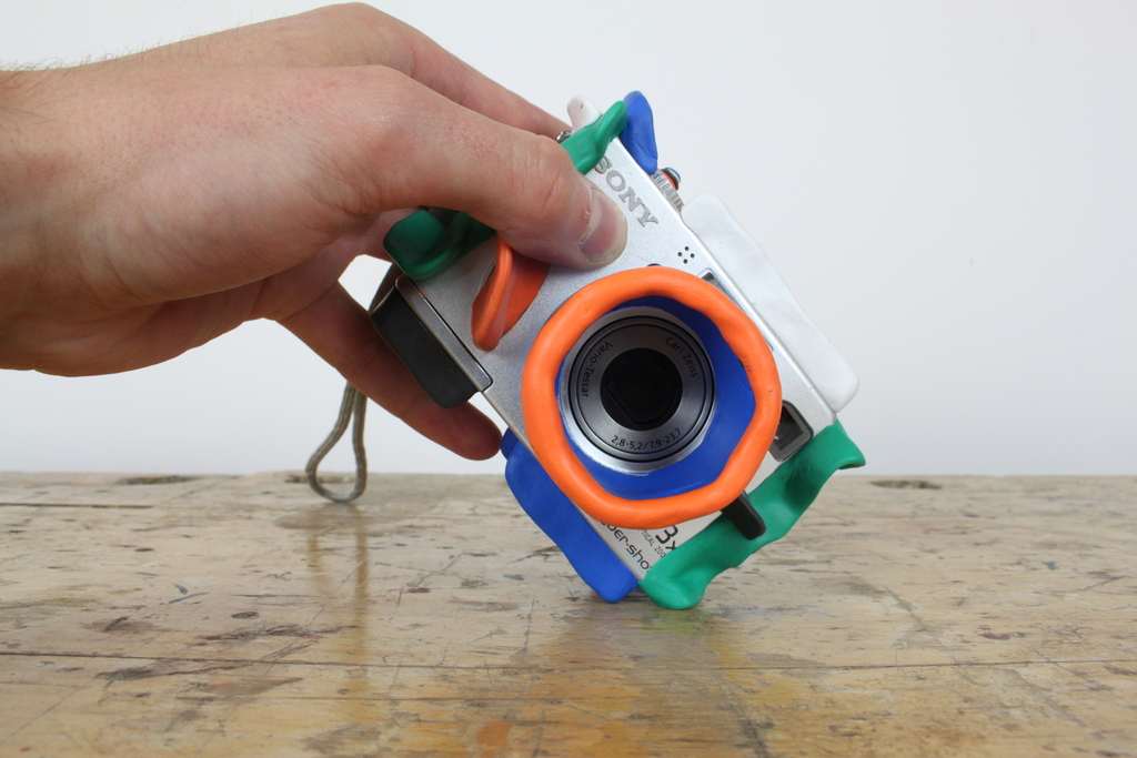 Camera with Sugru protection being held on table