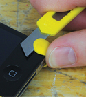 Sharp blade being used to cut off Sugru from iPhone