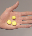 three balls of Sugru being held